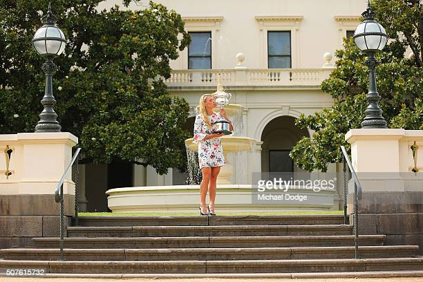 Angelique Kerber of Germany holds the Daphne Akhurst Memorial Cup during a photocall at Government House after winning the 2016 Australian Open on...