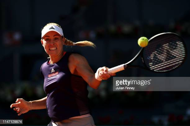 Angelique Kerber of Germany in action against Lesia Tsurenko of Ukraine during day two of the Mutua Madrid Open at La Caja Magica on May 05, 2019 in...