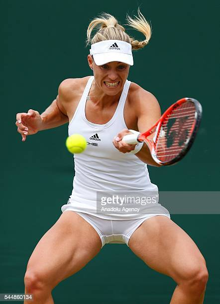 Angelique Kerber of Germany in action against Misaki Doi of Japan in the women's singles on day eight of the 2016 Wimbledon Championships at the All...