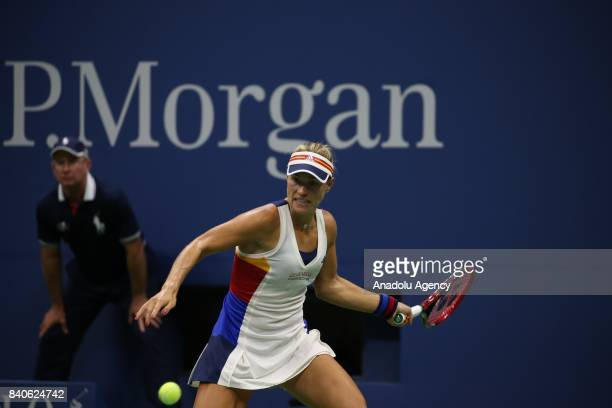 Angelique Kerber of Germany in action against Naomi Osaka of Japan during women's singles match within 2017 US Open Tennis Championships at Arthur...