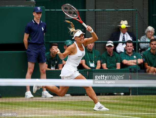 Angelique Kerber of Germany in action against Serena Williams of USA in the women's singles finals match on day twelve of the 2016 Wimbledon...