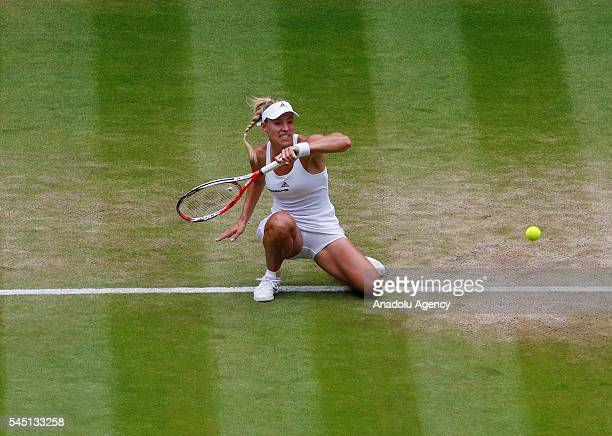 Angelique Kerber of Germany in action against Simona Halep of Romania in the women's singles quarter final on the day eight of the 2016 Wimbledon...
