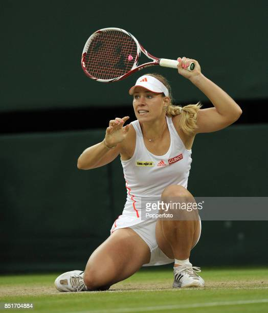 Angelique Kerber of Germany in action during her Ladies' Singles quarterfinal match against Sabine Lisicki of Germany on Day Eight of the Wimbledon...