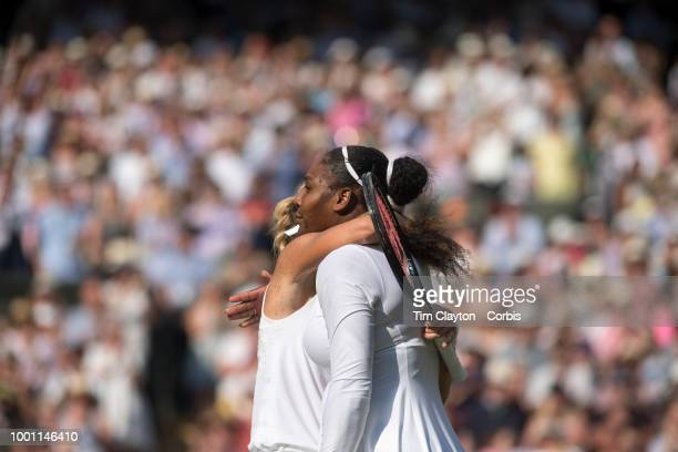 Angelique Kerber of Germany is embraced by Serena Williams of the United States after her victory in the Ladies' Singles Final on Center Court during...