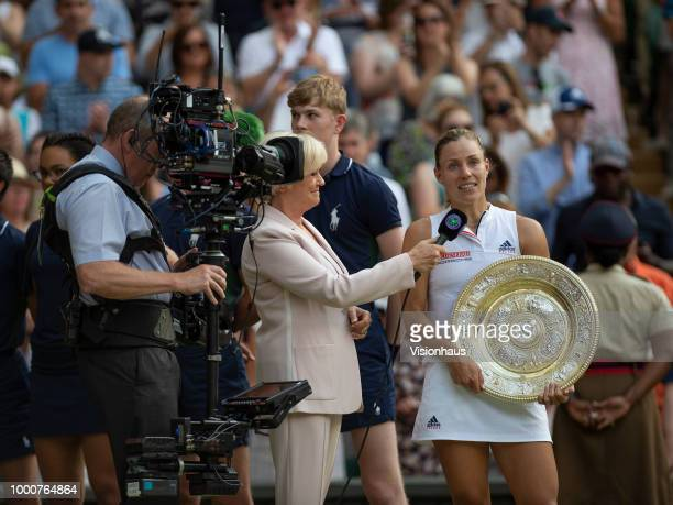 Angelique Kerber of Germany is interviewed by Sue Barker of the BBC after winning the Ladies' Singles title against Serena Williams of USA on day...