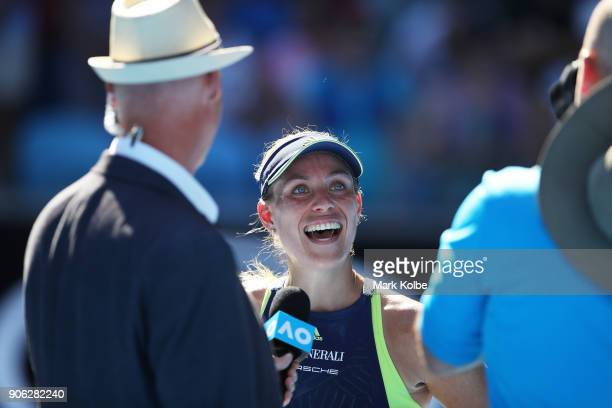 Angelique Kerber of Germany is interviewed on court after winning match point in her second round match against Donna Vekic of Croatia on day four of...