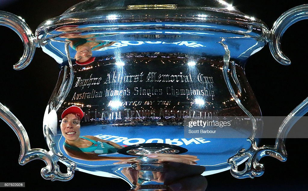 Angelique Kerber of Germany is reflected in the Daphne Akhurst Trophy after winning the Women's Singles Final against Serena Williams of the United States during day 13 of the 2016 Australian Open at Melbourne Park on January 30, 2016 in Melbourne, Australia.