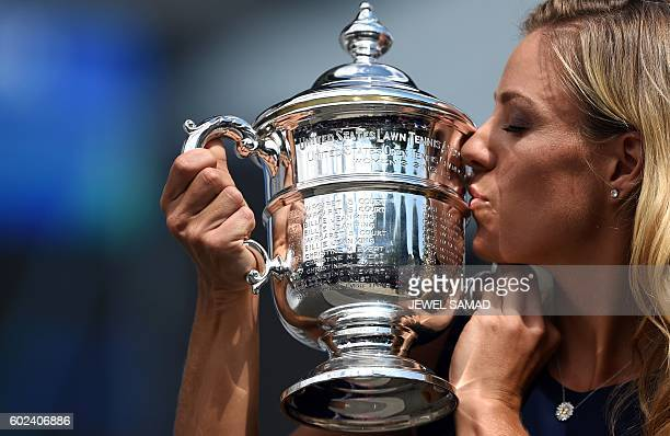 Angelique Kerber of Germany kisses her 2016 US Open Womens Singles champion trophy at the USTA Billie Jean King National Tennis Center in New York on...