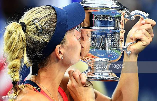 Angelique Kerber of Germany kisses the trophy after winning , , against Karolina Pliskova of the Czech Republic in their Women's Singles Final Match...