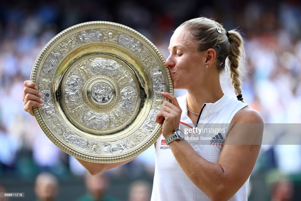 Angelique Kerber of Germany kisses the Venus Rosewater Dish as she poses for photographs after defeating Serena Williams of The United States in the Ladies' Singles final on day twelve of the Wimbledon Lawn Tennis Championships at All England Lawn Tennis and Croquet Club on July 14, 2018 in London, England.