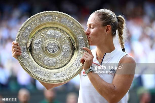 Angelique Kerber of Germany kisses the Venus Rosewater Dish as she poses for photographs after defeating Serena Williams of The United States in the...