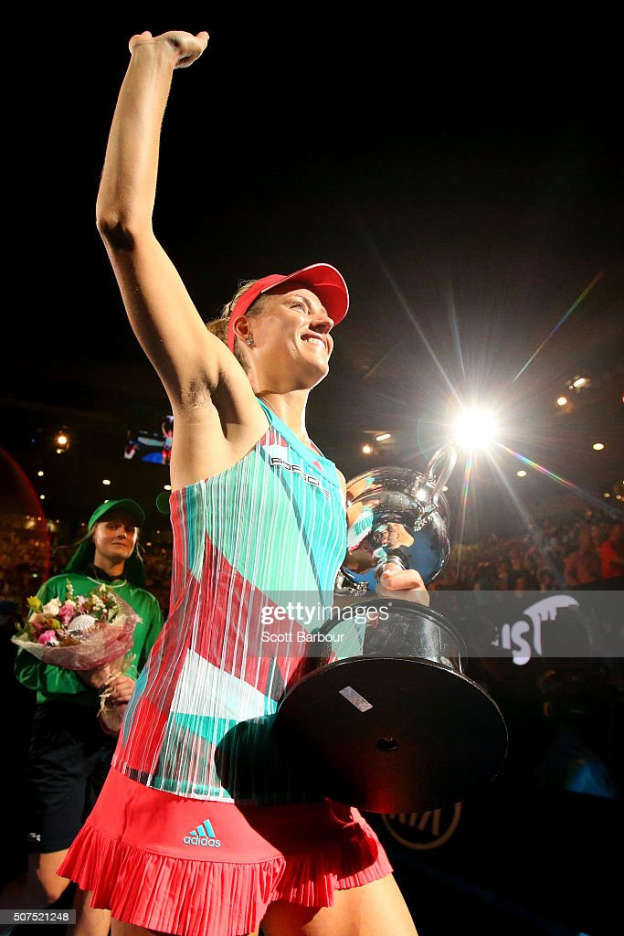 Angelique Kerber of Germany leaves Rod Laver Arena with the Daphne Akhurst Trophy after winning the Women's Singles Final against Serena Williams of the United States during day 13 of the 2016 Australian Open at Melbourne Park on January 30, 2016 in Melbourne, Australia.