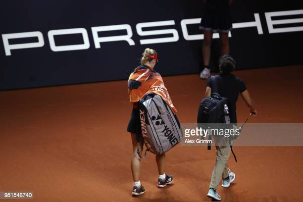 Angelique Kerber of Germany leaves the court after retiring from her match against Anett Kontaveit of Estonia during day 4 of the Porsche Tennis...