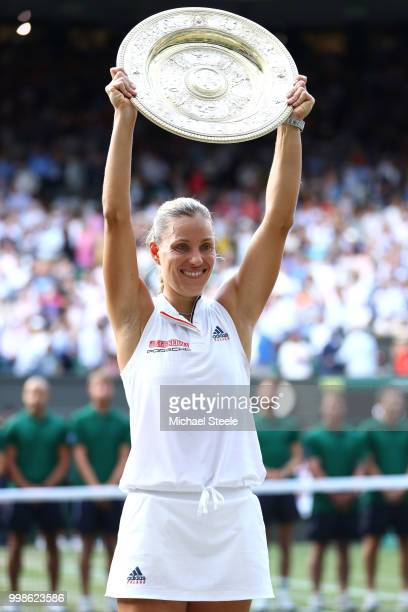 Angelique Kerber of Germany lifts the Venus Rosewater Dish after defeating Serena Williams of The United States in the Ladies' Singles final on day...