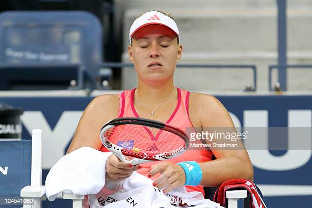 Angelique Kerber of Germany looks on as she sits down during a changeover against Samantha Stosur of Australia during Day Thirteen of the 2011 US...