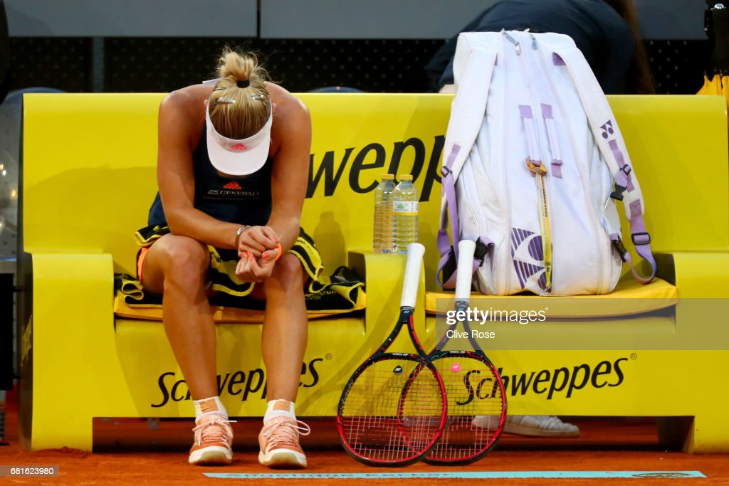 Angelique Kerber of Germany looks on in frustration after injuring herself during her match against Eugenie Bouchard of Canada on day five of the Mutua Madrid Open tennis at La Caja Magica on May 10, 2017 in Madrid, Spain.
