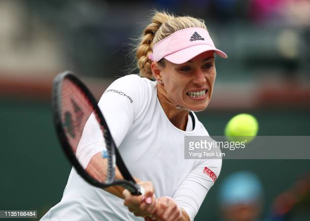 Angelique Kerber of Germany plays a backhand against Natalia Vikhlyantseva of Russia during their women's singles third round match on Day 8 of the...