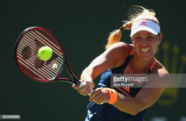 Angelique Kerber of Germany plays a backhand against Pauline Parmentier of France in their third round match during day eight of the BNP Paribas Open...