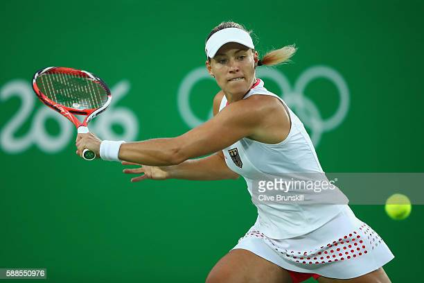 Angelique Kerber of Germany plays a backhand during the women's singles quarterfinal match against Johanna Konta of Great Britain on Day 6 of the...