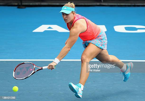 Angelique Kerber of Germany plays a backhand in her game against Sabine Lisicki of Germany during day four of the 2012 ASB Classic at ASB Tennis...