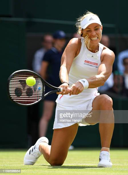 Angelique Kerber of Germany plays a backhand in her Ladies' Singles first round match against Tatjana Maria of Germany during Day two of The...