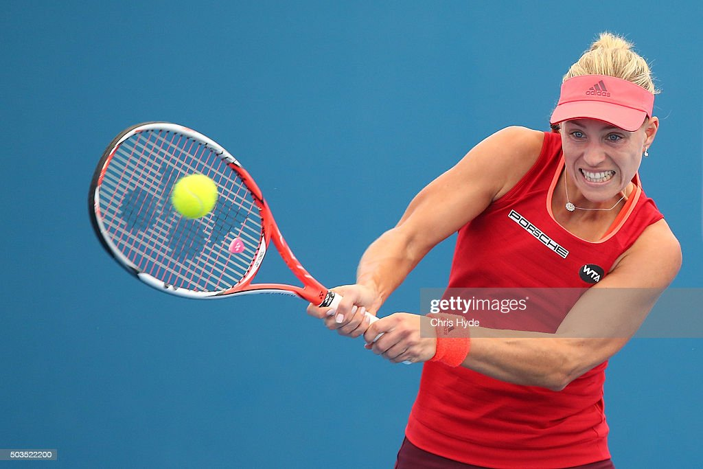Angelique Kerber of Germany plays a backhand in her match against Madison Brengle of the USA during day four of the 2016 Brisbane International at Pat Rafter Arena on January 6, 2016 in Brisbane, Australia.