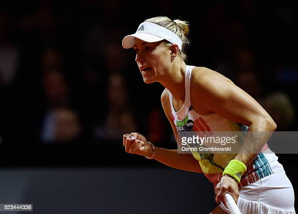 Angelique Kerber of Germany plays a backhand in her semi final match against Petra Kvitova of Czech Republic during Day 6 of the Porsche Tennis Grand...