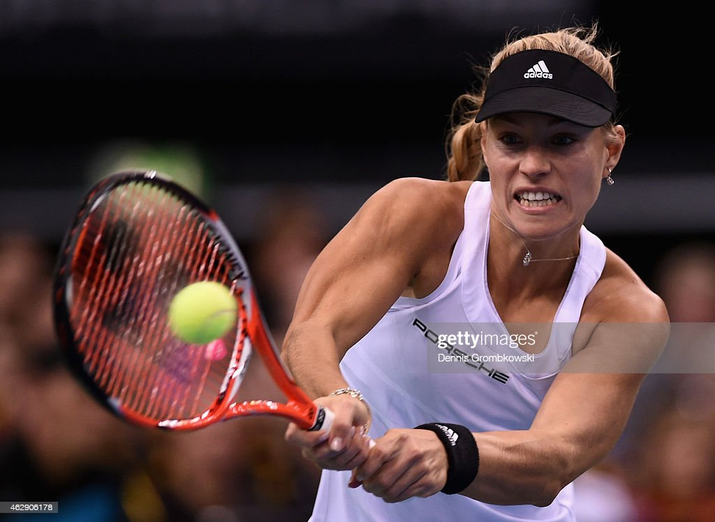 Angelique Kerber of Germany plays a backhand in her single match against during the Fed Cup 2015 World Group First Round tennis between Germany and Australia at Porsche-Arena on February 7, 2015 in Stuttgart, Germany.