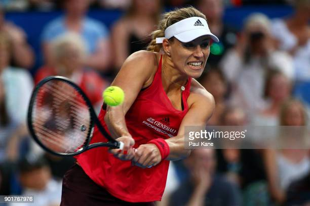 Angelique Kerber of Germany plays a backhand in her singles finals match against Belinda Bencic of Switzerland on day eight during the 2018 Hopman...