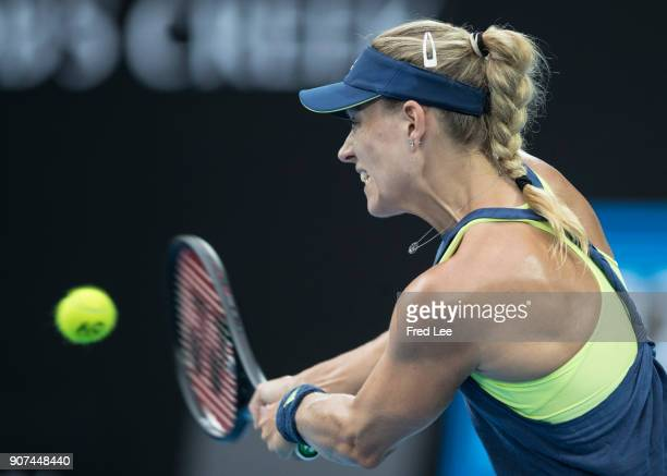 Angelique Kerber of Germany plays a backhand in her third round match against Maria Sharapova of Russia on day six of the 2018 Australian Open at...