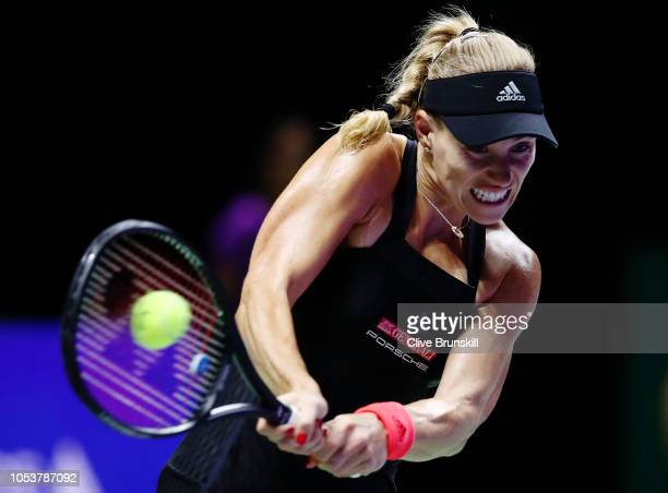 Angelique Kerber of Germany plays a backhand in her Women's singles match against Sloane Stephens of the United States during day 6 of the BNP...