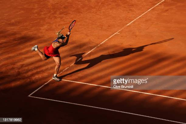 Angelique Kerber of Germany plays a backhand in their ladies singles third round match against Jesena Ostapenko of Latvia during Day Six of the...