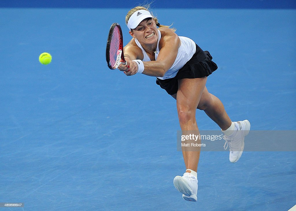 Angelique Kerber of Germany plays a backhand shot against Samantha Stosur of Australia during the Fed Cup Semi Final tie between Australia and Germany at Pat Rafter Arena on April 20, 2014 in Brisbane, Australia.