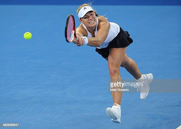 Angelique Kerber of Germany plays a backhand shot against Samantha Stosur of Australia during the Fed Cup Semi Final tie between Australia and...