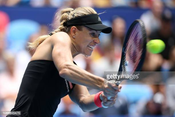 Angelique Kerber of Germany plays a backhand to Alize Cornet of France during day five of the 2019 Hopman Cup at RAC Arena on January 02 2019 in...
