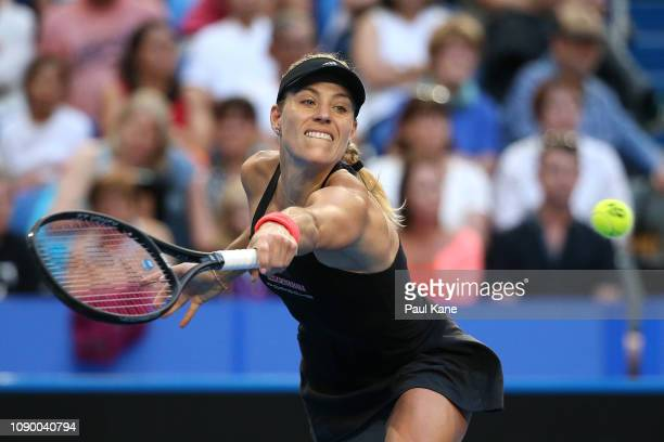 Angelique Kerber of Germany plays a backhand to Belinda Bencic of Switzerland during day eight of the 2019 Hopman Cup at RAC Arena on January 05,...