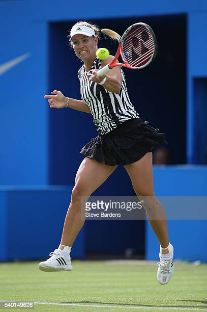 Angelique Kerber of Germany plays a forehand during her women's singles first round match against Shuai Peng of China on day two of the WTA Aegon...