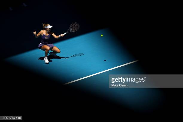 Angelique Kerber of Germany plays a forehand during her Women's Singles third round match against Camila Giorgi of Italy on day six of the 2020...