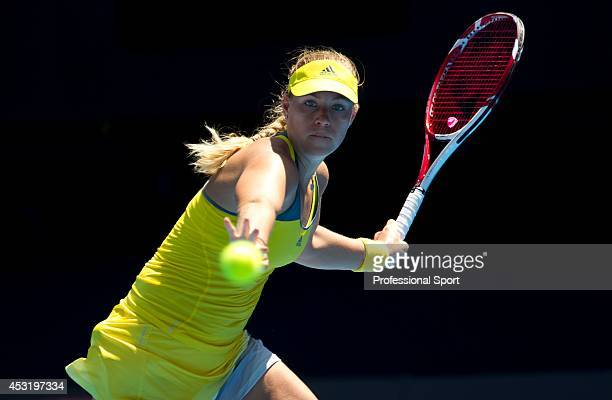 Angelique Kerber of Germany plays a forehand in her fourth round match against Ekaterina Makarova of Russia during day seven of the 2013 Australian...