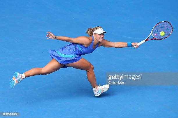 Angelique Kerber of Germany plays a forehand in her fourth round match against Flavia Pennetta of Italy during day seven of the 2014 Australian Open...