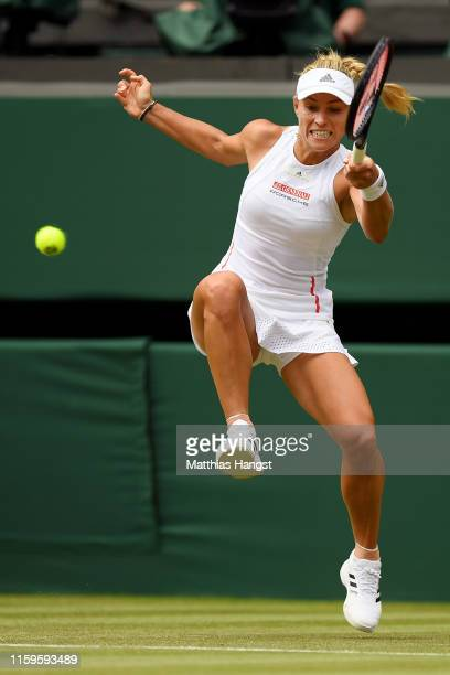 Angelique Kerber of Germany plays a forehand in her Ladies' Singles first round match against Tatjana Maria of Germany during Day two of The...
