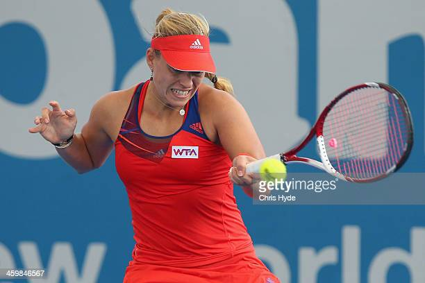 Angelique Kerber of Germany plays a forehand in her match against Anastasia Pavlyuchenkova of Russia during day four of the 2014 Brisbane...