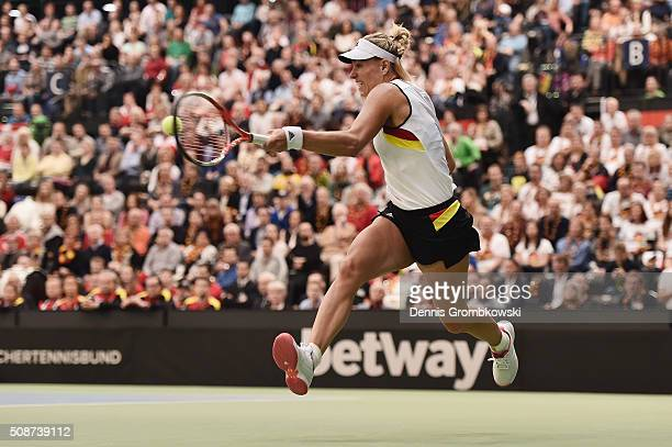 Angelique Kerber of Germany plays a forehand in her match against Timea Bacsinszky of Switzerland during Day 1 of the 2016 Fed Cup World Group First...