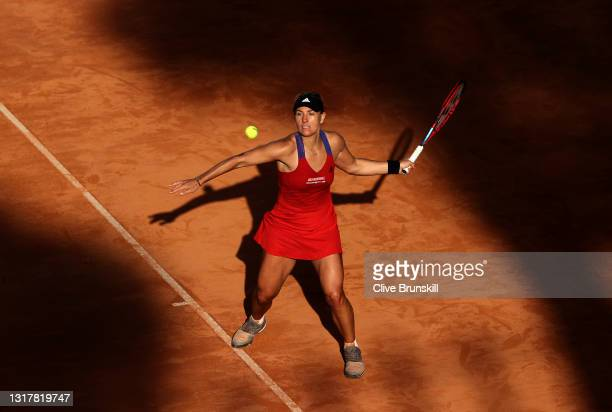 Angelique Kerber of Germany plays a forehand in their ladies singles third round match against Jesena Ostapenko of Latvia during Day Six of the...