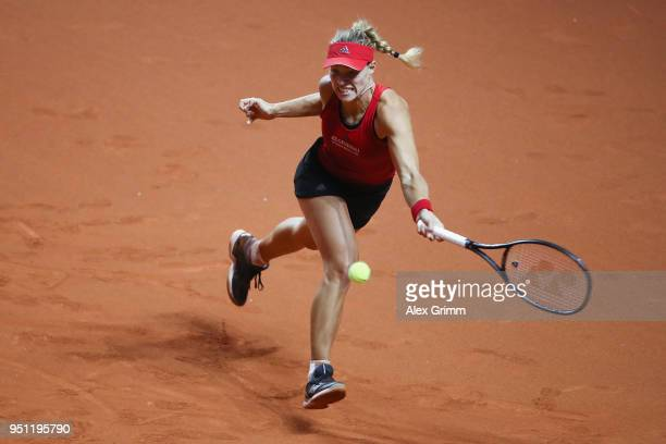 Angelique Kerber of Germany plays a forehand to Petra Kvitova of Czech Republic during day 3 of the Porsche Tennis Grand Prix at PorscheArena on...