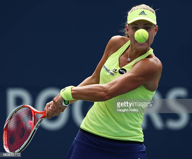 Angelique Kerber of Germany plays a shot against Simona Halep of Romania during Day 4 of the Rogers Cup at the Aviva Centre on August 13 2015 in...