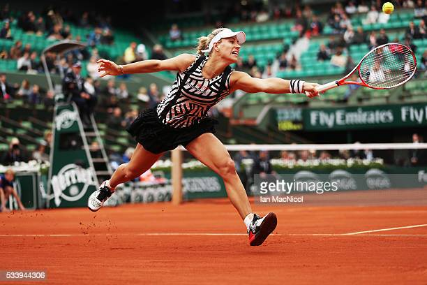 Angelique Kerber of Germany plays a shot during the Women's Singles first round match against kiki Bertens of Netherlands on day three of the 2016...