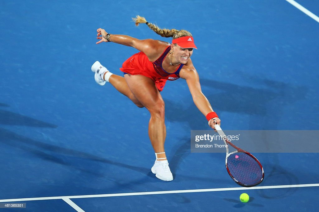 Angelique Kerber of Germany plays a volley in her quarter final match against Carla Suarez Navarro of Spain during day four of the 2014 Sydney International at Sydney Olympic Park Tennis Centre on January 8, 2014 in Sydney, Australia.