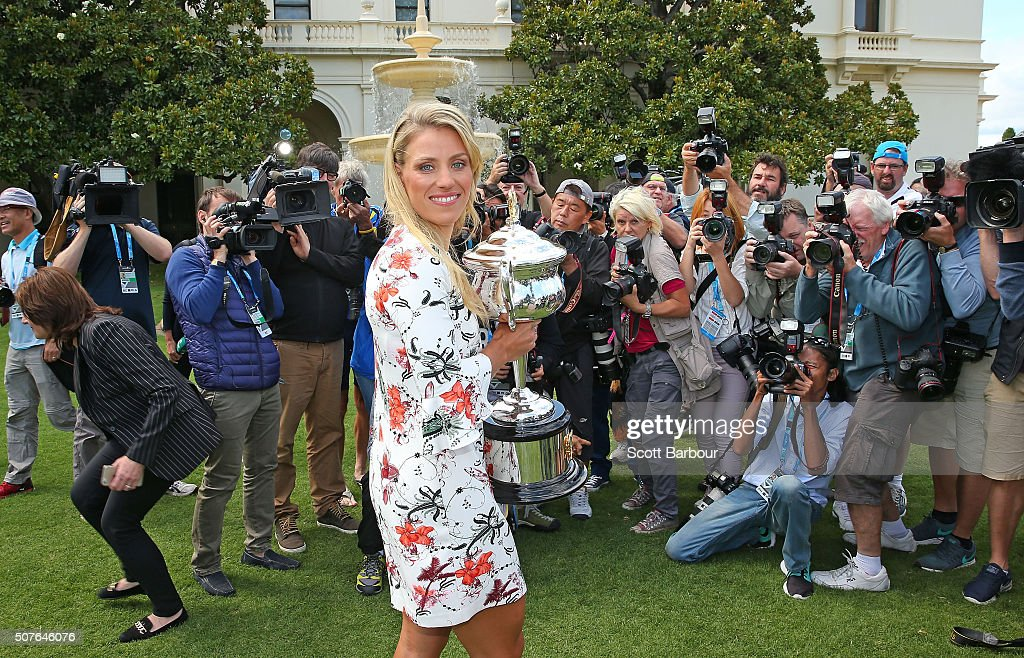 Angelique Kerber of Germany poses for photographers as she holds the Daphne Akhurst Memorial Cup during a photocall at Government House after winning the 2016 Australian Open on January 31, 2016 in Melbourne, Australia.