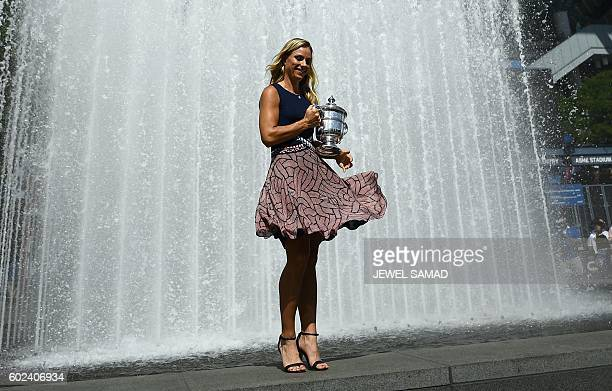 TOPSHOT Angelique Kerber of Germany poses with her 2016 US Open Womens Singles champion trophy at the USTA Billie Jean King National Tennis Center in...